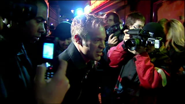 exterior night shots of graham norton arriving for elton john david furnish's stag party at the too2much venue in soho on december 20 2005 in london... - stag night stock videos & royalty-free footage
