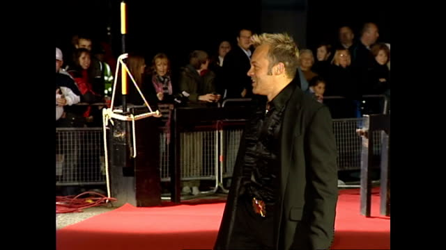 Exterior night shots of Graham Norton posing for photos on the red carpet at the National Television Awards at the Royal Albert Hall on October 28...