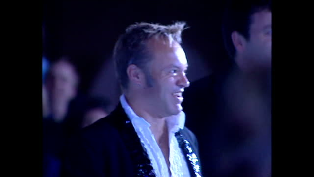 exterior night shots of graham norton walking along the blue carpet at the national lottery anniversary at the tate modern on november 06, 2004 in... - anniversary stock videos & royalty-free footage