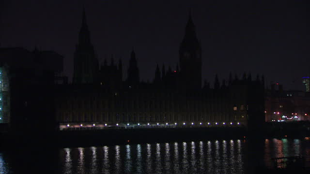 exterior night shots of houses of parliament and elizabeth tower big ben clock turning lights off for earth hour on march 28 2014 in london england - earth hour stock videos & royalty-free footage