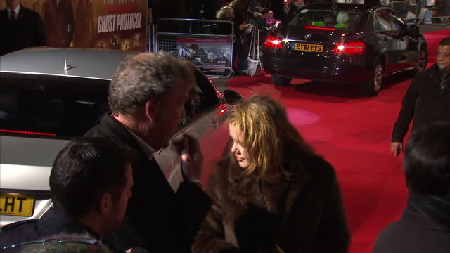 exterior night shots of jeremy clarkson and his daughter arriving at mission impossible 4 ghost protocol film premiere and posing for photographs on... - jeremy clarkson stock videos & royalty-free footage