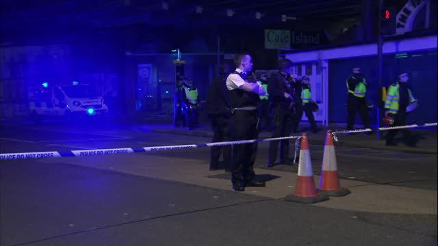 exterior night shots of large numbers of police at the scene of the terror attack in borough market, including armed police officers guarding the... - terrorism stock videos & royalty-free footage