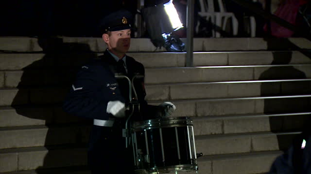 exterior night shots of male and female australian soldiers performing march salute with guns at anzac memorial dawn service with drummer playing in... - anzac day stock videos & royalty-free footage