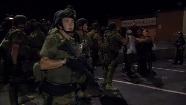 exterior night shots of members of the national guard surging forwards to arrest and restrain a protester pinning him to the ground as other officers... - national guard stock videos and b-roll footage