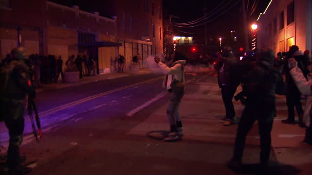 Exterior night shots of Missouri Highway Patrol Captain Ronald Johnson on the streets with other police officers during confrontations between...