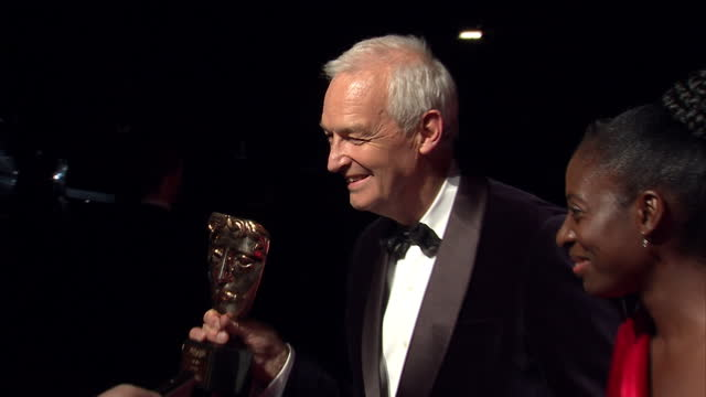 exterior night shots of news reporter jon snow holding bafta award and signing autographs on the red carpet at the tv bafta awards at theatre royal... - jon snow journalist stock-videos und b-roll-filmmaterial