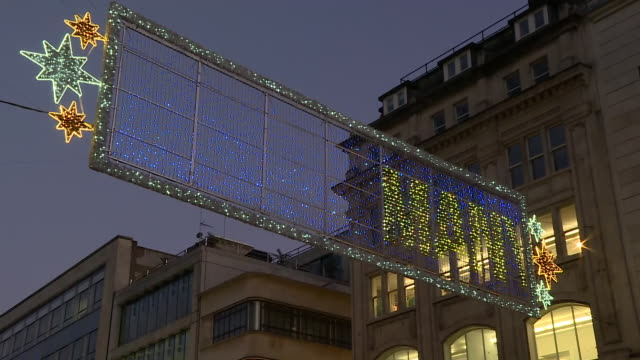 exterior night shots of oxford street christmas lights with shoppers, buses and other traffic passing on 2 november 2020 in london, united kingdom - fairy lights stock videos & royalty-free footage