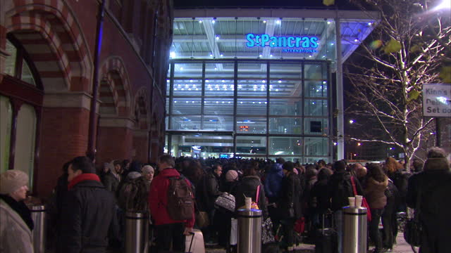 Exterior night shots of passengers queuing up outside St Pancras train station after Eurostar services were cancelled because of the weather Heavy...