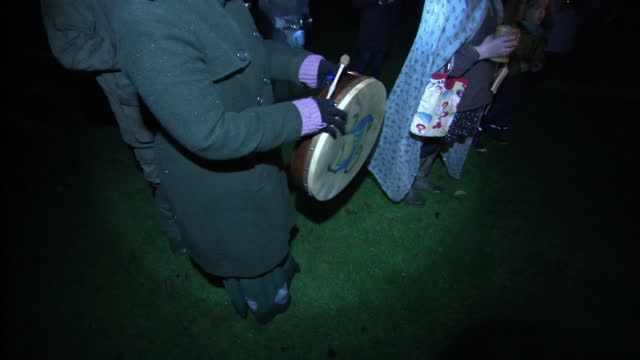 exterior night shots of people dressed up and singing in apple orchard during apple wassailing at exmoor national park on january 07, 2017 in... - exmoor national park stock videos & royalty-free footage