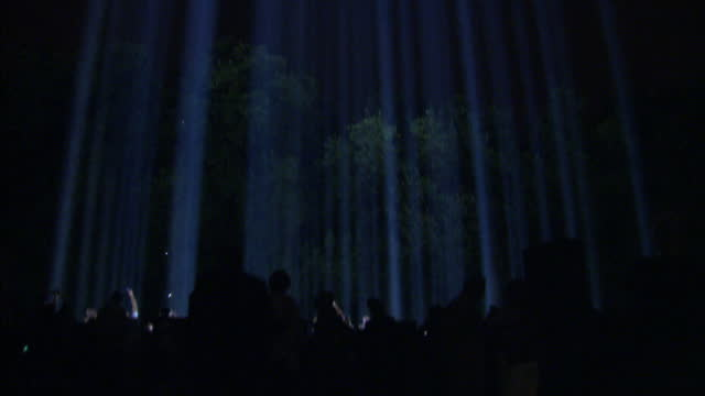 exterior night shots of pillars of lights beaming up into the sky from victoria tower gardens as people wander in between the light beams taking... - 100th anniversary stock videos & royalty-free footage