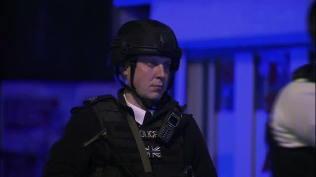 Exterior night shots of police officers standing at a cordon near the scene of the terror attack in Borough Market including an armed police officer...