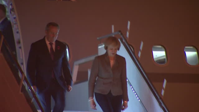 exterior night shots of prime minister theresa may and liam fox international trade secretary disembarking from a plane and departing in a motorcade... - liam fox politician stock videos and b-roll footage