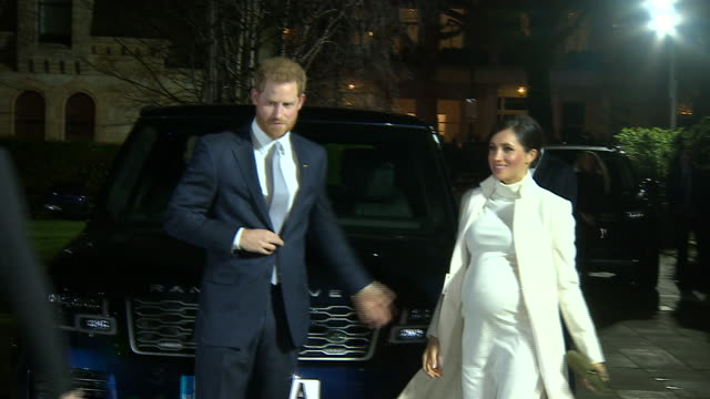 exterior night shots of prince harry, duke of sussex and meghan, duchess of sussex arriving the natural history museum to attend the gala performance... - gala stock videos & royalty-free footage