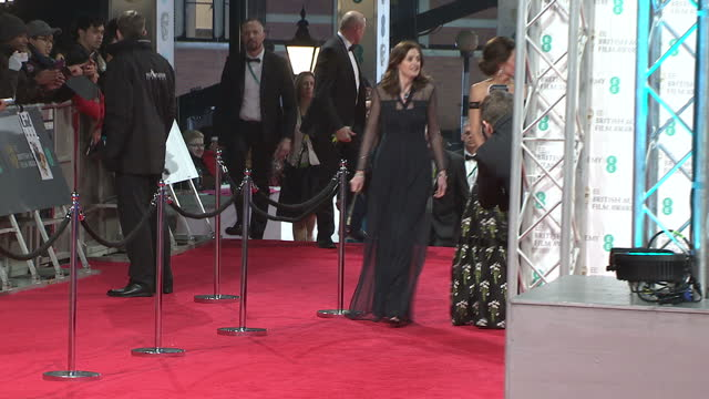 Exterior night shots of Prince William and Catherine Duchess of Cambridge walk along the red carpet arriving at the BAFTA Awards