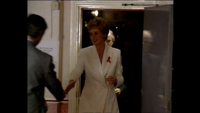 exterior night shots of princess diana arriving at venue for concert of hope aids charity event at wembley arena and shake hands with officials on... - wembley arena stock videos & royalty-free footage