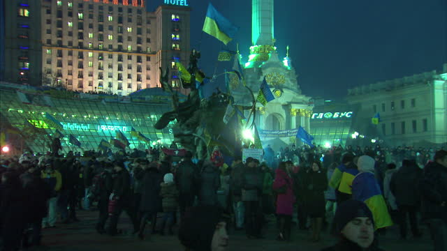 Exterior night shots of proEurope protesters in Independence Square waving or wearing Ukrainian and EU flags Protesters in Kiev continue to...