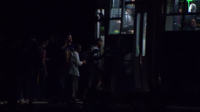Exterior night shots of refugees migrants boarding buses and being driven away toward Austria to carry on journey across Europe on September 15 2015...