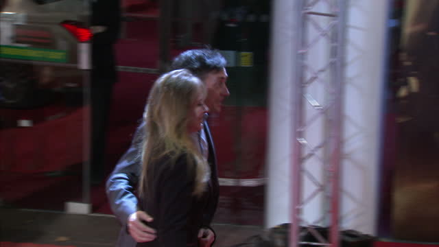 exterior night shots of richard hammond and wife mindy hammond arriving at mission impossible 4 ghost protocol film premiere and posing for... - richard hammond stock videos & royalty-free footage