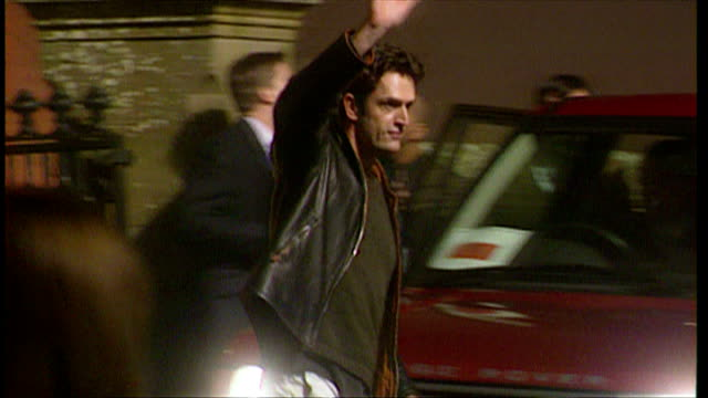 exterior night shots of rupert everett leaving dornoch cathedral after madonna and guy ritchie's son rocco's christening. on december 27, 2000 in... - celebrities video stock e b–roll