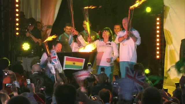 exterior night shots paralympic cauldron being lit by representatives from england, scotland, wales & northern ireland at a ceremony in stoke... - flaming torch stock videos & royalty-free footage