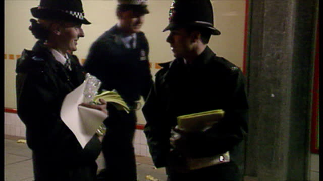Exterior night shots police officers standing outside of nightclub handing out leaflets to clubbers about the death of Leah Betts caused by taking...