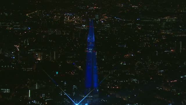 exterior night shots the shard skyscraper lit up by light laser show exterior night shot aerials the shard illuminated by laser show the shard tower... - lighting equipment stock videos & royalty-free footage