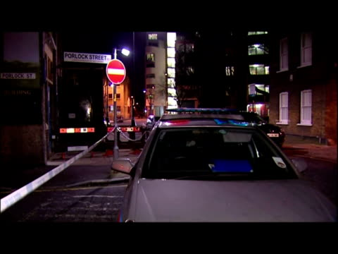 vídeos de stock e filmes b-roll de exterior night shots various of forensic officers examining crime scene at porlock street south east london - porlock