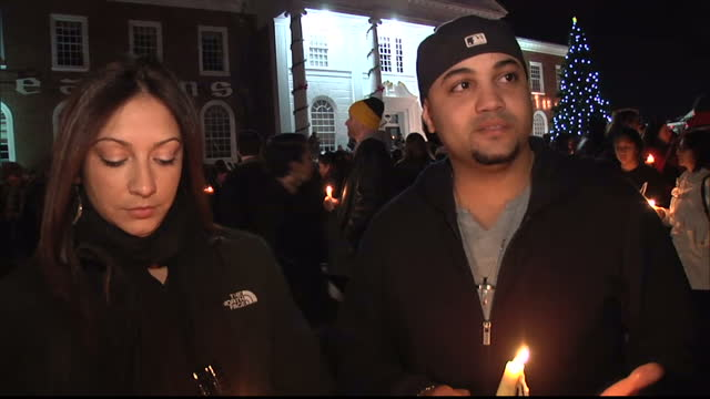 exterior night shots voxpops with a couple outside church vigil newtown candlelit vigil voxpops on december 15 2012 in newtown connecticut - newtown connecticut stock videos & royalty-free footage