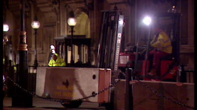 exterior night shots workmen building concrete block barricade around the houses of parliament to deter potential terror attacks on the parliament... - barricade stock videos & royalty-free footage