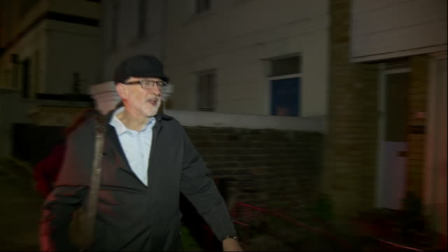 exterior night time shots of jeremy corbyn arriving at his home whilst reporters ask him questions regarding his support for a general election on 26... - jeremy corbyn stock videos & royalty-free footage