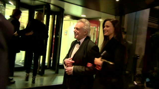 Exterior night time shots of Peter Stringfellow arriving with his wife Bella Wright for the Tory Party Fundraiser Black and White Ball at the...