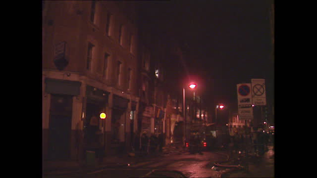 exterior night views of the aftermath of a fire at dream city cinema in clerkenwell, as fire crew work at the scene after the fire has been put out... - building exterior stock videos & royalty-free footage