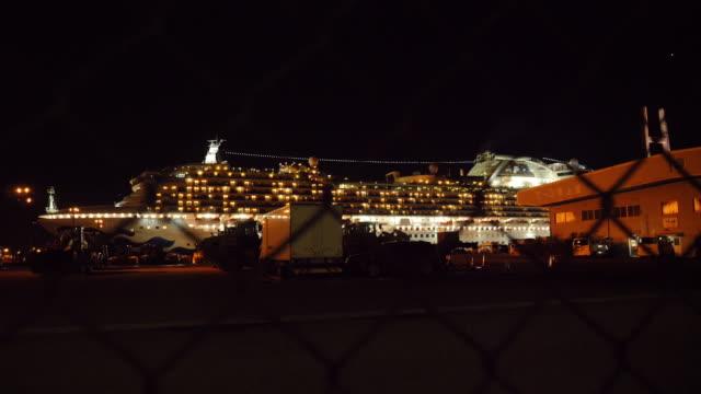 exterior night views of the diamond princess cruise ship, docked and quarantined in yokohama port due to coronavirus outbreak on 17 february 2020 in... - cruise stock videos & royalty-free footage