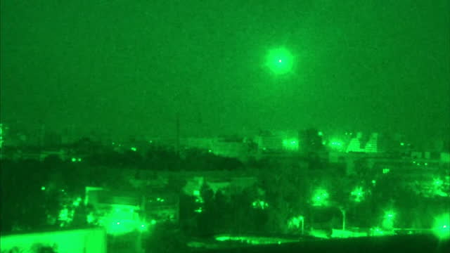 Exterior night vision shots antiaircraft fire over Damascus flashes from explosions Exterior night vision flare over the city Exterior night vision...