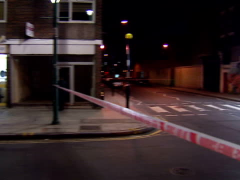 exterior nightshots police car police cordon tape at the scene of the shooting with fast food takeaway restaurant on the corner a teenage girl is in... - hackney stock videos & royalty-free footage