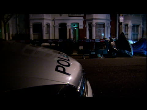 exterior nightshots police forensic officers outside the house two men are being questioned after human remains were found buried in a garden in west... - human back stock videos & royalty-free footage