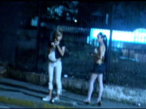vídeos de stock, filmes e b-roll de exterior nightshots prostitutes working girls on the streets of caracas with one girl getting into waiting car prostitutes on the streets of caracas... - prostituta