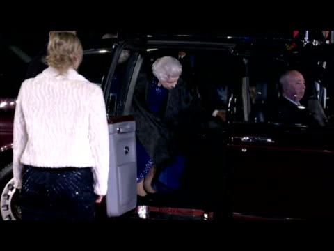 Exterior nightshots the Queen steps out from limousine with Prince Philip behind walks over to greet officials outside the Odeon cinema in Leicester...
