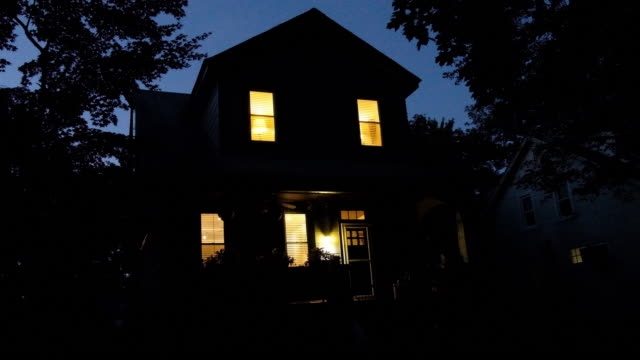 exterior of a freestanding house during the evening. - front stoop stock videos and b-roll footage