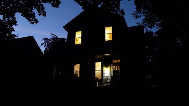 exterior of a freestanding house during the evening. - house stock videos & royalty-free footage