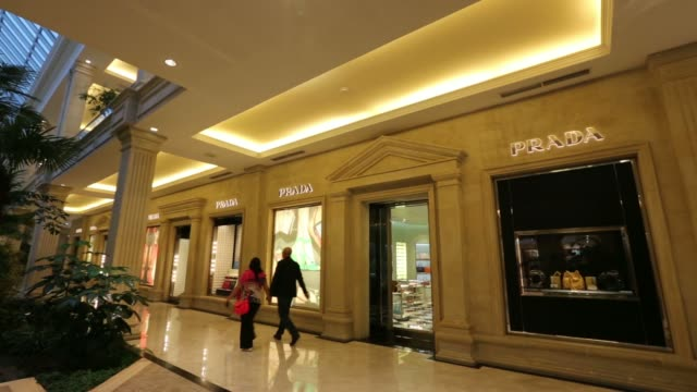 exterior of a furla spa store inside the new vegas shopping mall, operated by crocus group, in moscow, russia, on tuesday, june 10 an employee... - purse stock videos & royalty-free footage