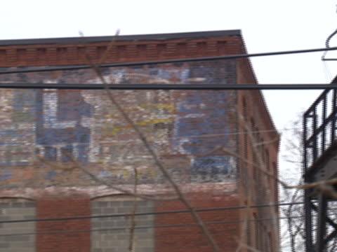 exterior of an abandoned mill in pontiac, michigan. - ポンティアック点の映像素材/bロール