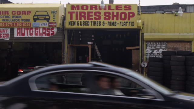 ms exterior of an auto/tire shop. - wide screen stock videos & royalty-free footage