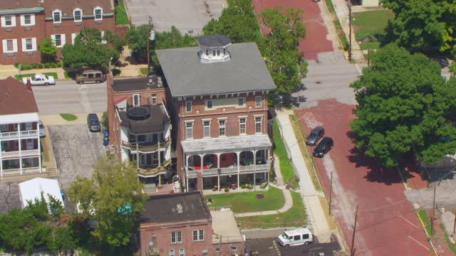 WS AERIAL POV Exterior of apartment building cars parked on street / Alton, Illinois, United States