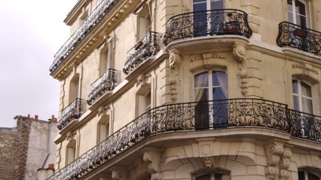 ms exterior of apartment building / paris, france - flat stock videos & royalty-free footage