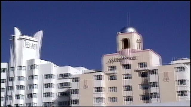 exterior of art deco hotels in miami - アールデコ地区点の映像素材/bロール