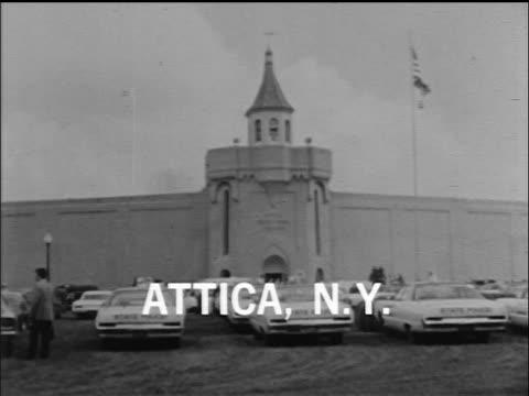 vídeos y material grabado en eventos de stock de exterior of attica state prison with parking lot in foreground / new york / newsreel - 1971