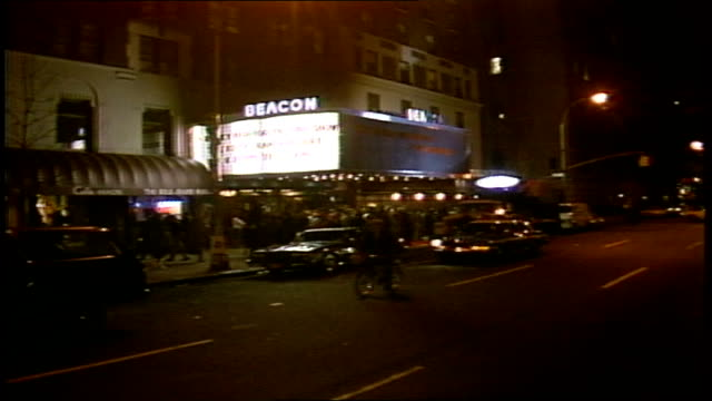 exterior of beacon theater at night and people in halloween costumes - 1985年点の映像素材/bロール