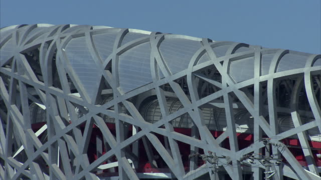 ms pan exterior of beijing national stadium / beijing, municipality of beijing, china - bird's nest stock videos & royalty-free footage