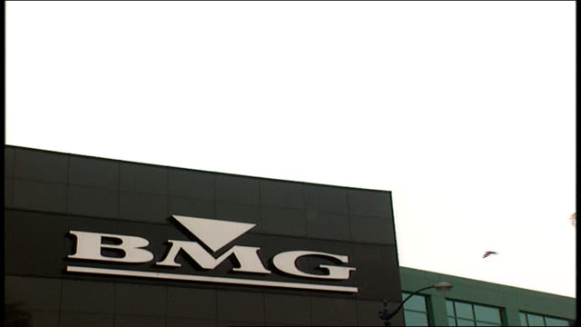 vídeos de stock, filmes e b-roll de exterior of bmg in los angeles california - 1996
